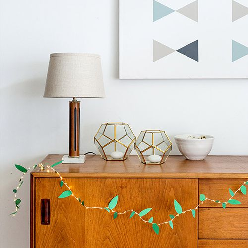 string lights with paper leaf cutouts