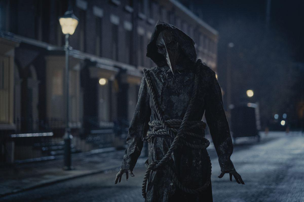 a creepy masked plague doctor figure