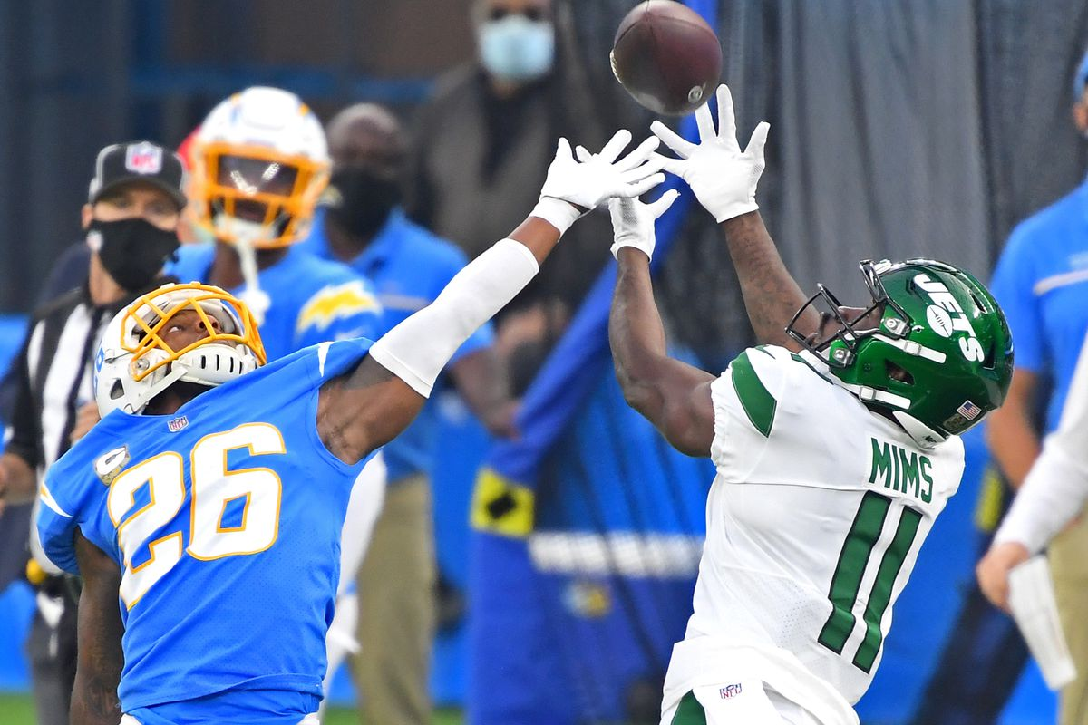 New York Jets wide receiver Denzel Mims (11) catches a pass against Los Angeles Chargers cornerback Casey Hayward (26) in the second half at SoFi Stadium.