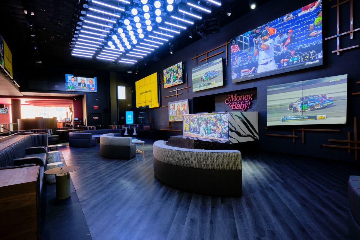 A dance floor with TVs behind it