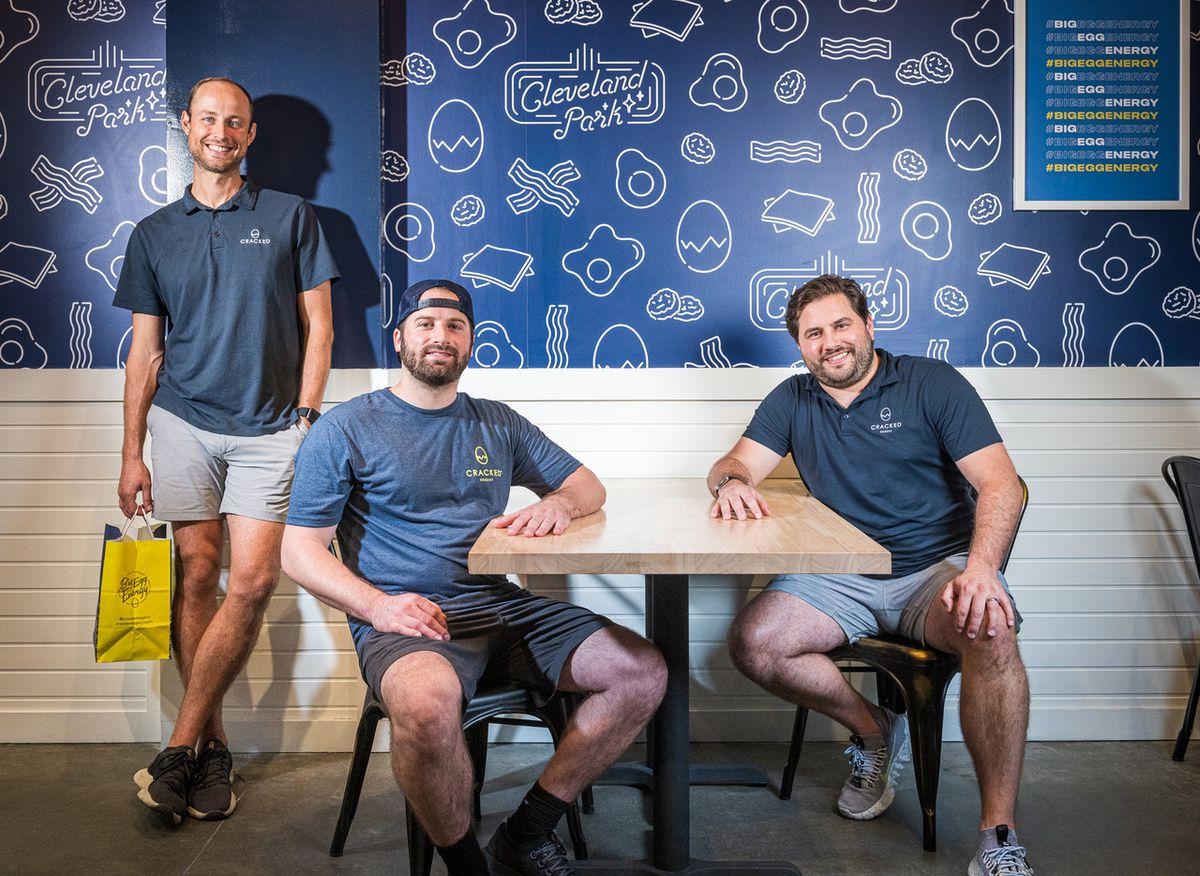 Cracked Eggery partners Ross Brickelmaier, AJ Zarinsky, and Mike Tabb pose for a photo at their new Cleveland Park restaurant