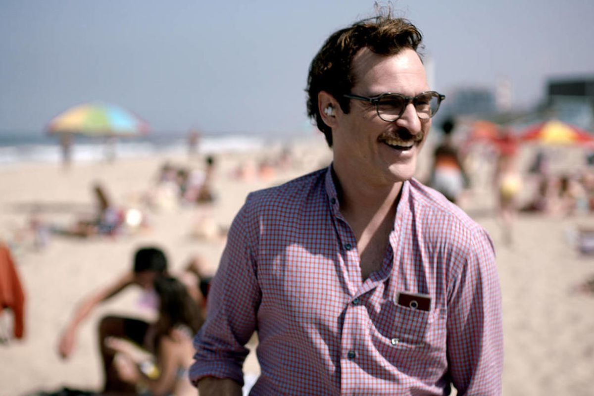 """This image released by Warner Bros. Pictures shows Joaquin Phoenix in a scene from the film, """"Her."""""""