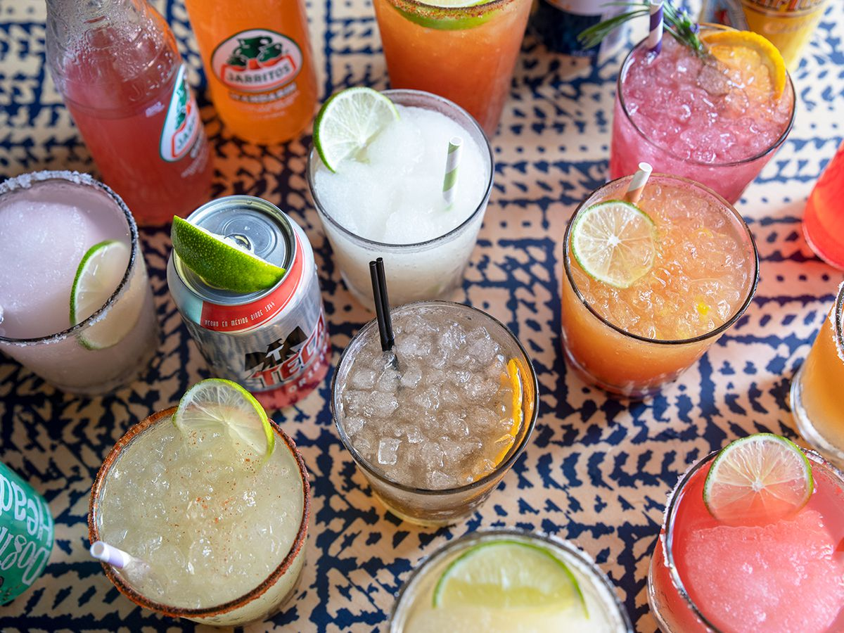 overhead shot of several margaritas in different colors