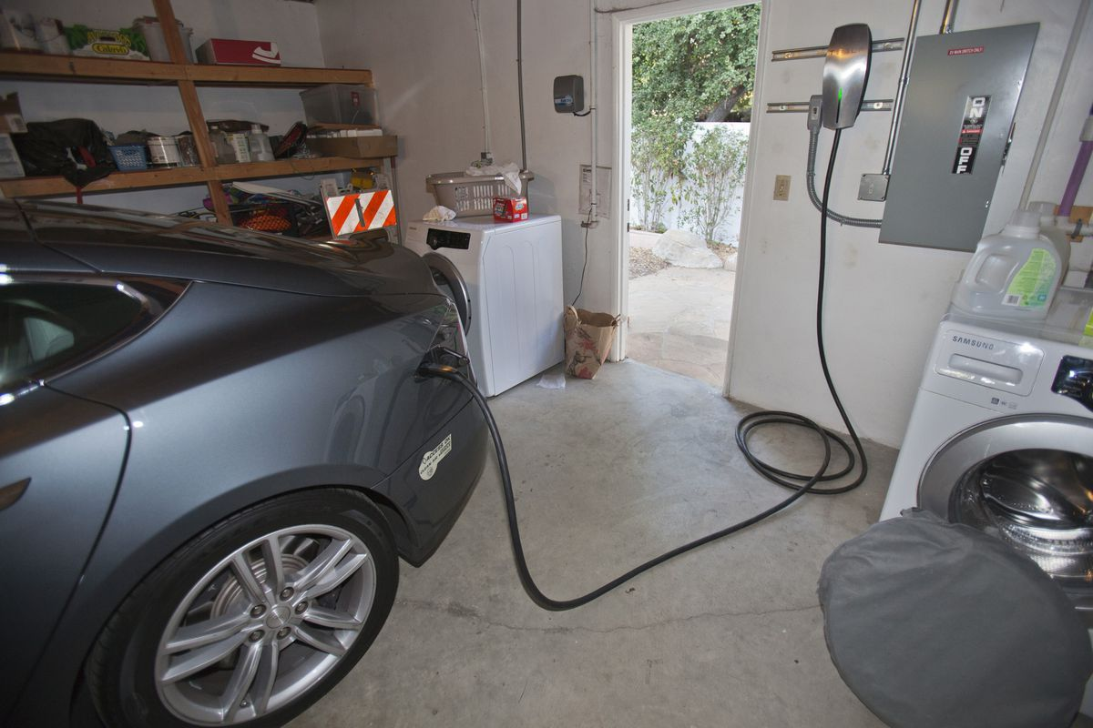 A Tesla car recharging