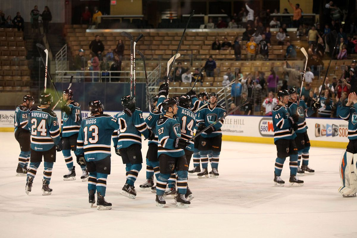 The Worcester Sharks salute the DCU Center home crowd after their 2-0 win over the Providence Bruins Saturday night.