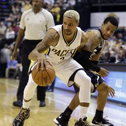 Indiana Pacers' George Hill (3) is defended by Utah Jazz's Trey Burke (3) during the first half of an NBA basketball game Saturday, Oct. 31, 2015, in Indianapolis. (AP Photo/Darron Cummings)