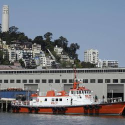In this photo taken Friday, April, 6, 2012, the pilot boat Drake is shown tied up at Pier 9, the home of the San Francisco Bar Pilots with Coit Tower in the background in San Francisco. Since the days of Mark Twain, the pilots have had it good. Thanks to political clout and highly specialized training, this cadre of 60 ship captains has for more than a century had control over guiding oil tankers and cargo ships in, out and around the San Francisco Bay.