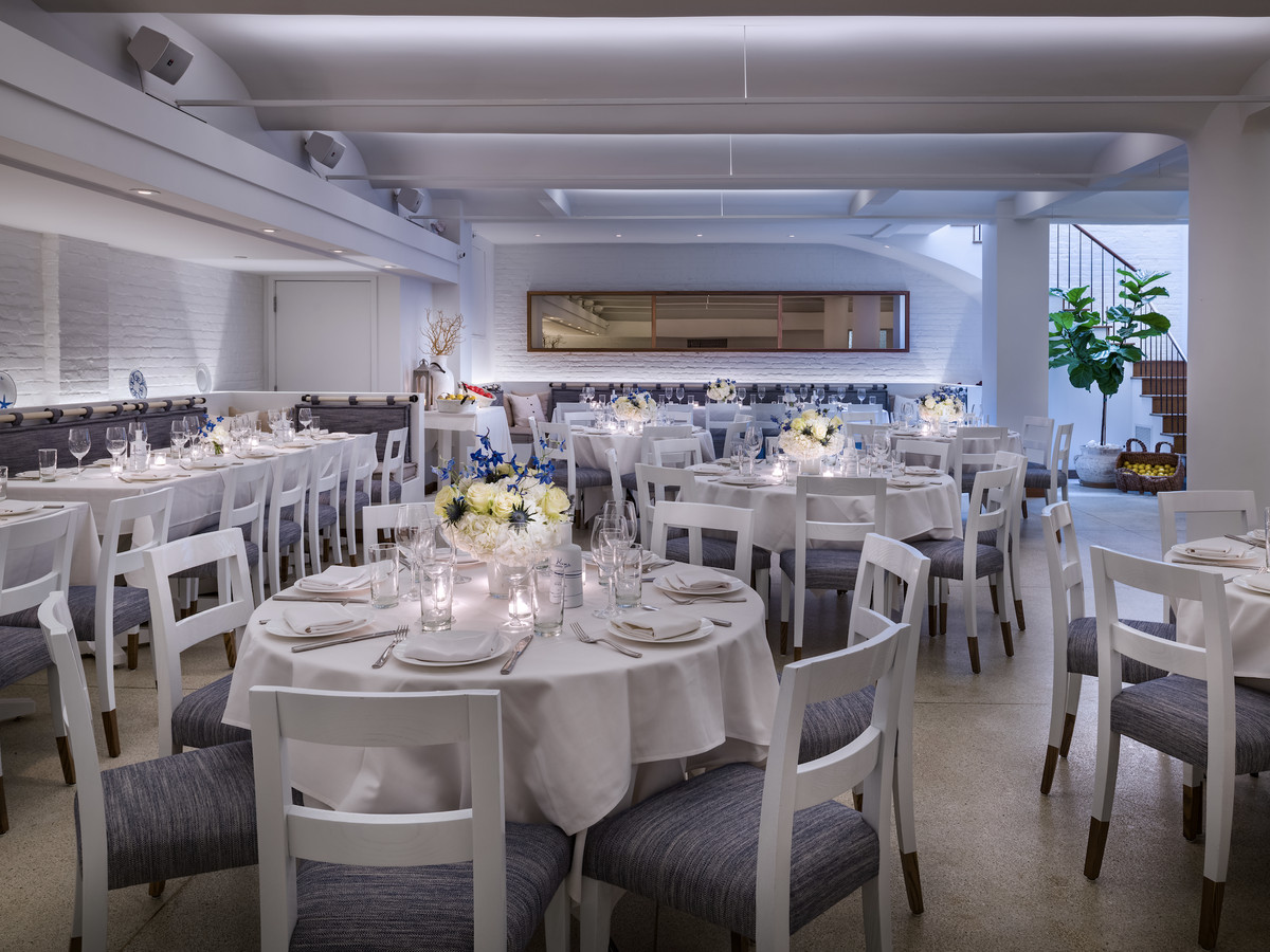 A white room with white tables and chairs