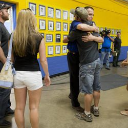 Members of the Prescott fire department embrace as they arrive to listen in at a news conference, Monday, July 1, 2013 in Prescott, Ariz. An out-of-control blaze overtook the Granite Mountain Hot Shots, an elite group of firefighters trained to battle the fiercest wildfires, killing 19 members as they tried to protect themselves from the flames under fire-resistant shields.   (AP Photo/Julie Jacobson)