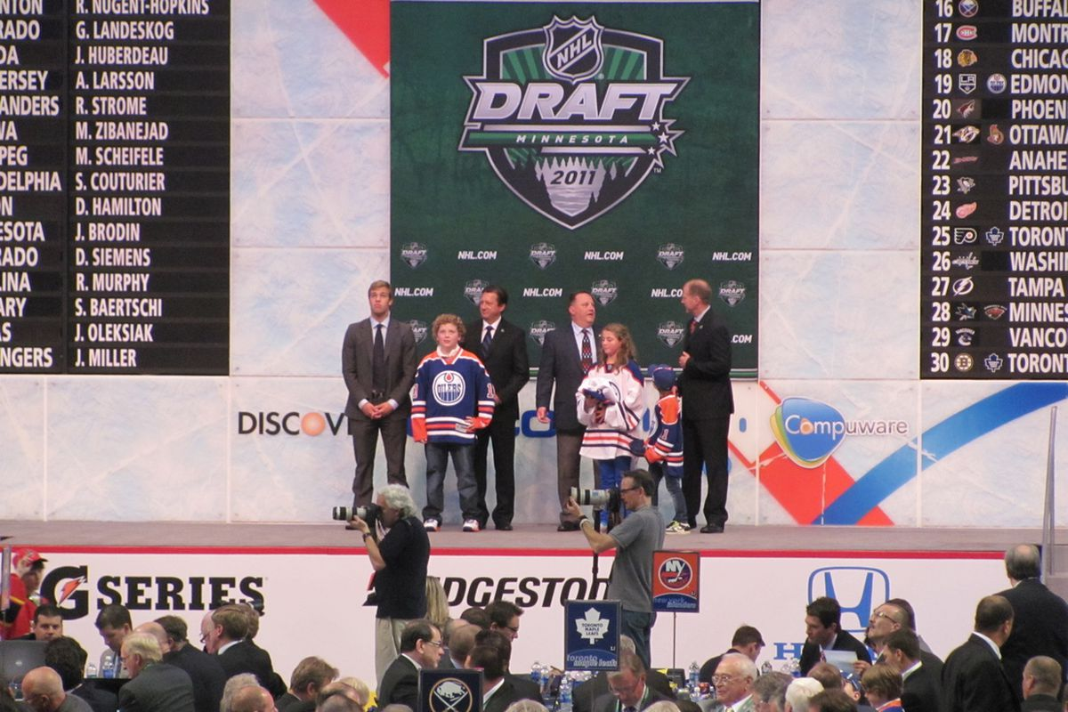 SteveTambellini takes Oscar Klefbom at the 2011 NHL entry draft. Photo by Lisa McRitchie all rights reserved