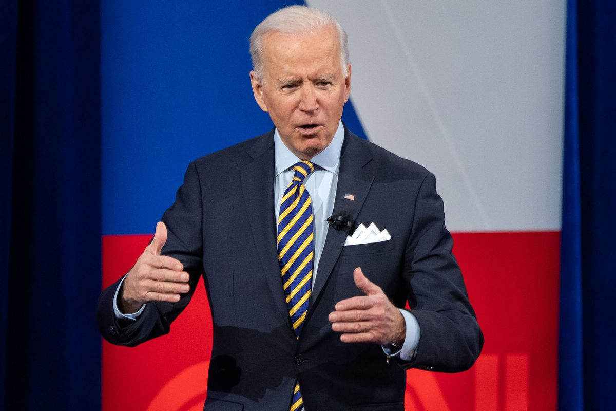 President Joe Biden gestures with both hands while speaking onstage during a CNN town hall event on February 16, 2021, at the Pabst Theater in Milwaukee.