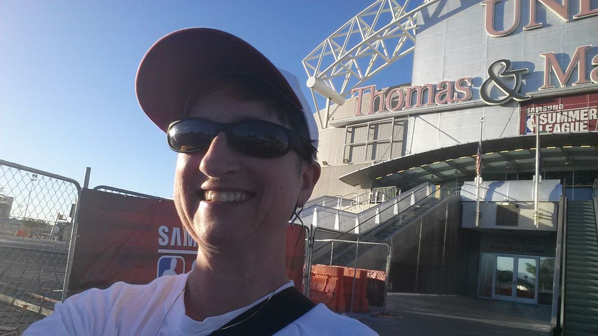 Blazer fan in front of the Thomas and Mack Arena at UNLV.