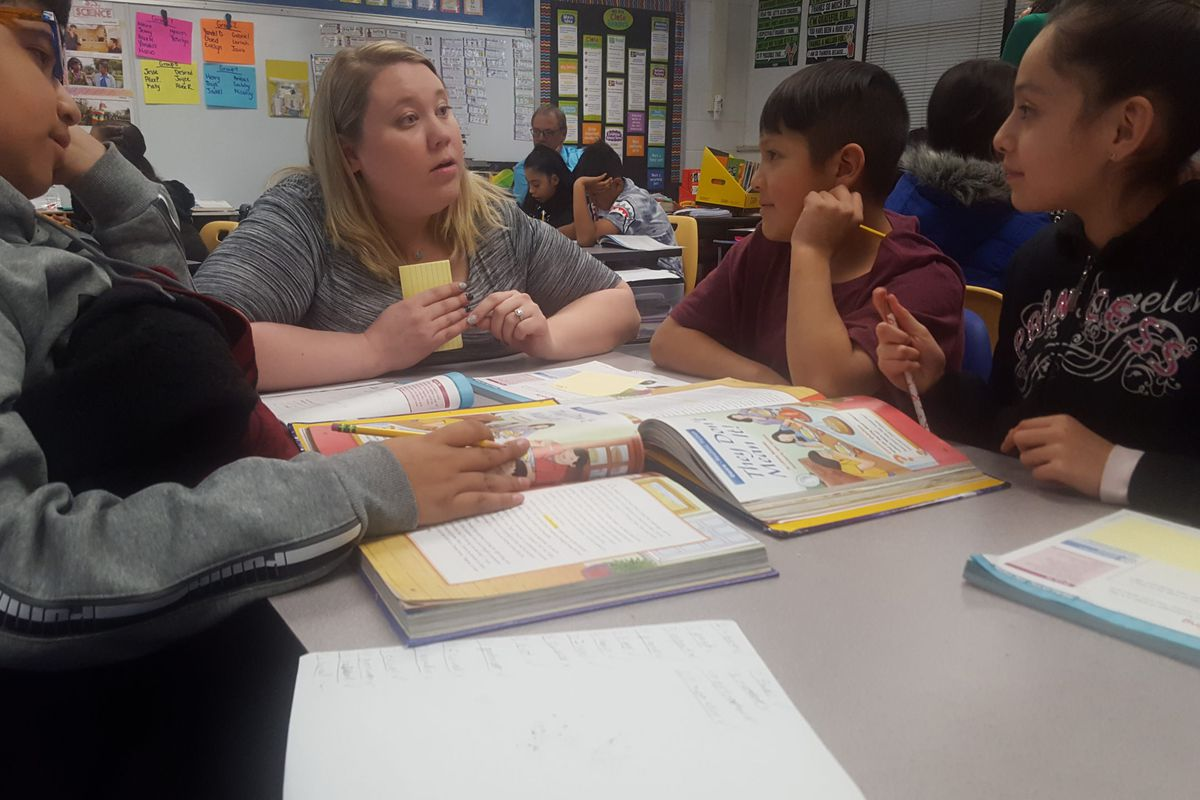 Fifth grade teacher Haley Stratton, talks with her students at Rose Hill Elementary in Adams 14.