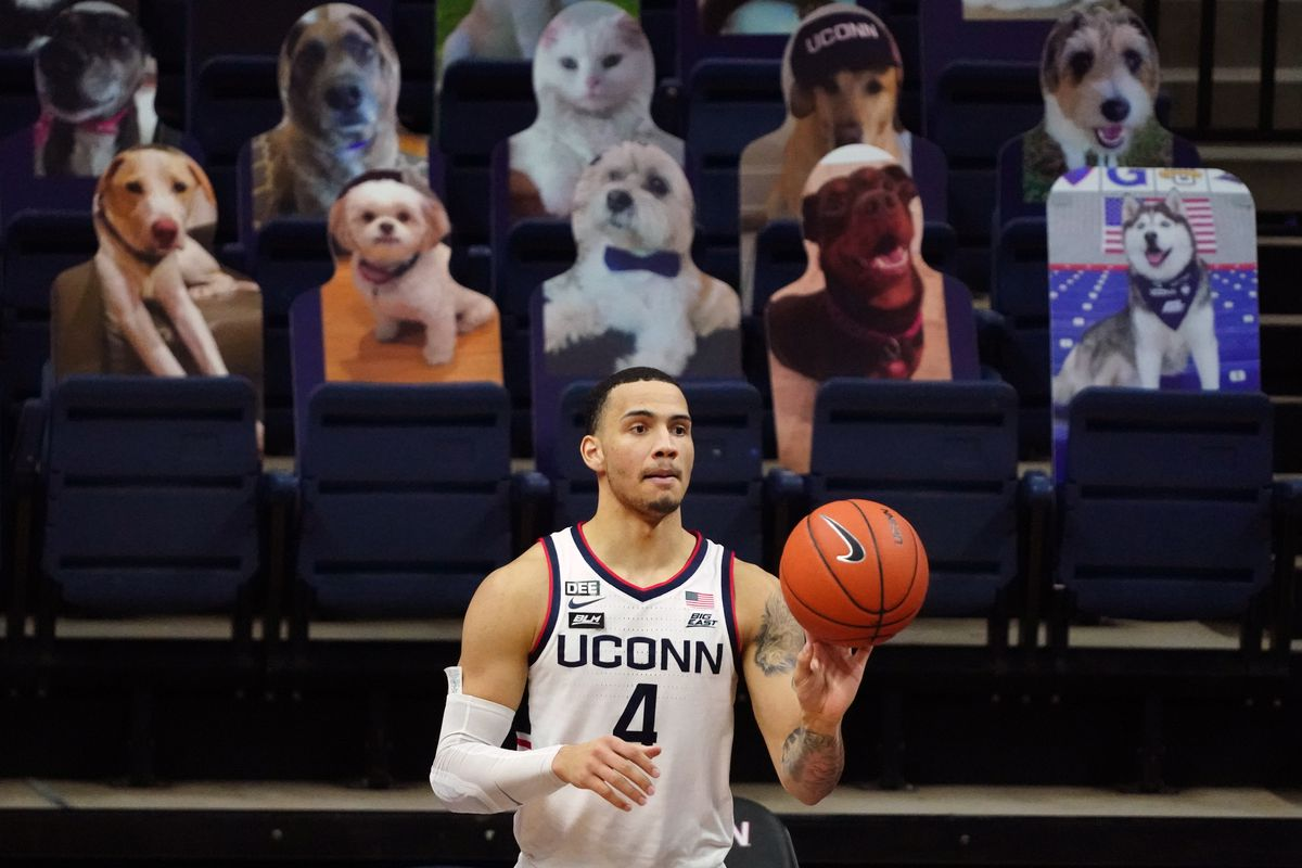 Connecticut Huskies guard Tyrese Martin inbounds the ball against the Butler Bulldogs in the second half at Harry A. Gampel Pavilion.