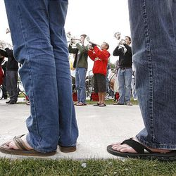 Members of the American Fork High Marching Band wear flip-flops to school Monday and during band practice as they prepare for the funeral of American Fork High band instructor Heather Christensen, who was killed in a bus accident on their way back from a band competition in Idaho over the weekend. They wore flip-flops in honor of Christensen, who loved wearing them.