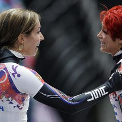 Katie Uhlaender of the United States, right, greets teammate Noelle Pikus-Pace after their  third runs during the women's skeleton competition at the 2014 Winter Olympics, Friday, Feb. 14, 2014, in Krasnaya Polyana, Russia.