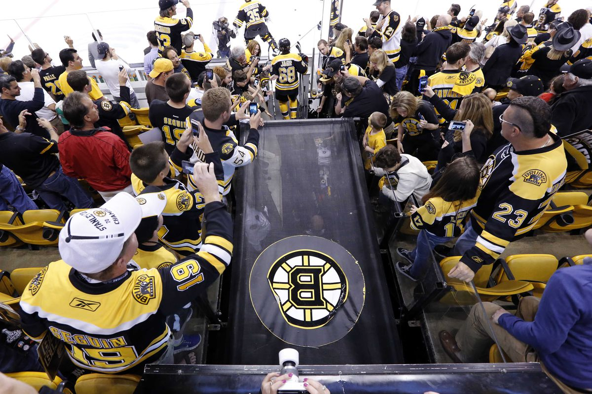 Cheering as the Bruins take to the ice