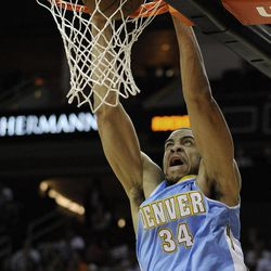 Denver Nuggets' JaVale McGee dunks during the first half of an NBA basketball game against the Houston Rockets on Monday, April 16, 2012, in Houston.