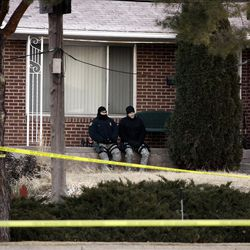 Law enforcement officers and crime scene investigators work at the scene of an overnight shooting at a home in Ogden Thursday, January 5, 2012.  Six officers, some from the Weber Morgan Narcotics Strike Force were shot while serving a warrant at 3268 Jackson Ave.