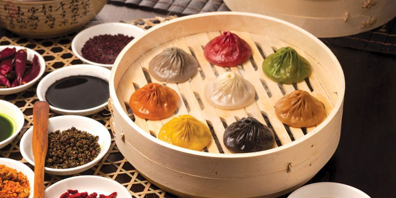 Paradise Dynasty's multi-colored soup dumplings in a tray.