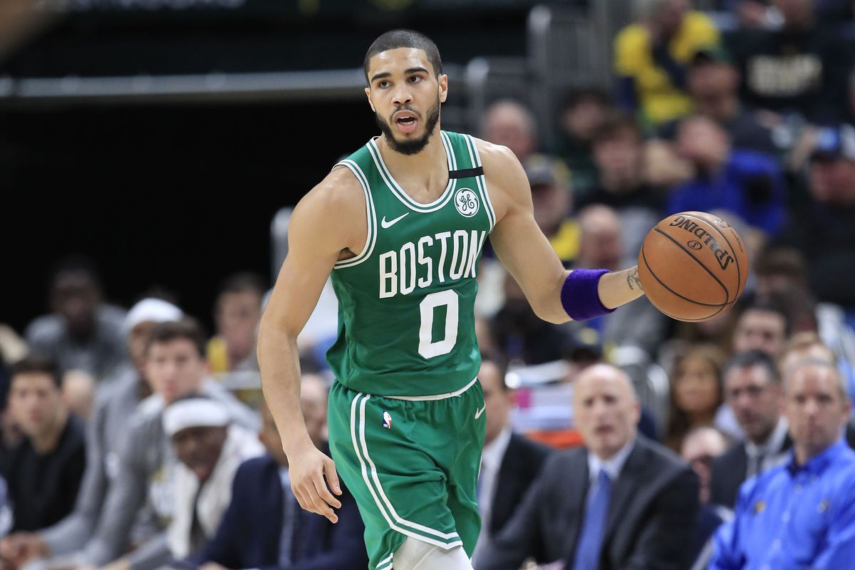 Jayson Tatum of the Boston Celtics dribbles the ball against the Indiana Pacers at Bankers Life Fieldhouse on March 10, 2020 in Indianapolis, Indiana.