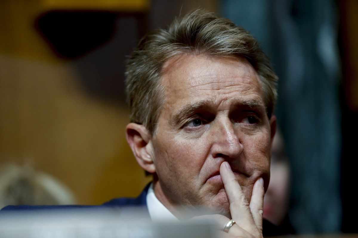 Sen. Jeff Flake, R-Ariz., attends a Senate Judiciary Committee meeting, Friday, Sept. 28, 2018 on Capitol Hill in Washington.