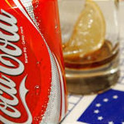 A Coca-Cola can sits on an EU luncheon tray at the European Commission headquarters. Coke has half the European soft drink market.