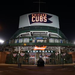 The bleacher gate illuminated by the stage lights in the FOX Sports broadcast stage area