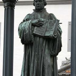 A bronze sculpture of Martin Luther holding the New Testament is seen on the market square in Wittenberg, eastern Germany, Tuesday, Oct. 31, 2006. German priest and church reformer Martin Luther on Oct. 31, 1517 pinned his controversial 95 theses on the door of the Wittenberg castle church, since 1667 protestant Christians celebrate the so called Reformation Day on Oct. 31.