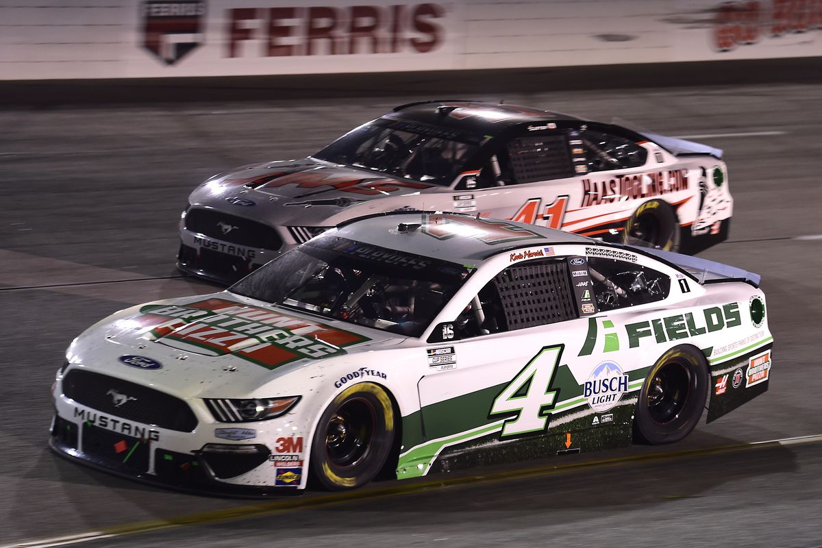 Kevin Harvick, driver of the #4 Hunt Brothers Pizza Ford, and Cole Custer, driver of the #41 HaasTooling.com Ford, race during the NASCAR Cup Series Federated Auto Parts 400 at Richmond Raceway on September 12, 2020 in Richmond, Virginia.