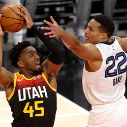 Utah Jazz guard Donovan Mitchell (45) goes at Memphis Grizzlies guard Desmond Bane (22) for a basket as the Utah Jazz and Memphis Grizzlies play Game 2 of their NBA playoffs first round series at Vivint Arena in Salt Lake City on Wednesday, May 26, 2021.