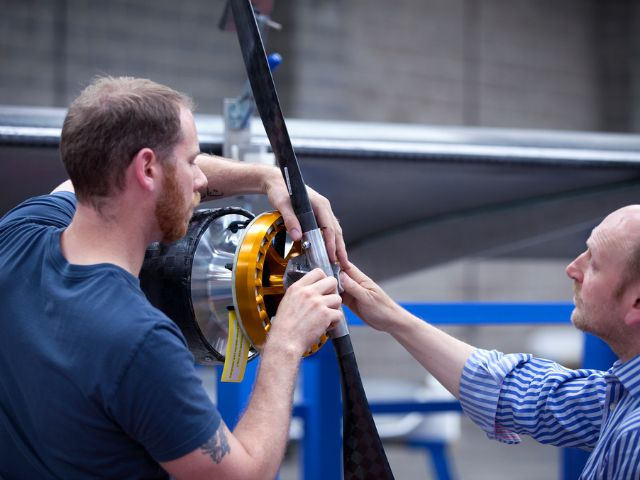 Engineers work on the propeller of Facebook's new Aquila plane.