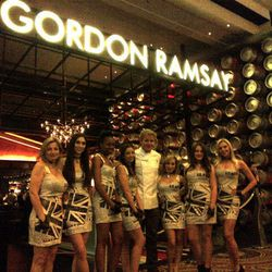 Gordon Ramsay with his cocktail servers in newsprint dresses at Gordon Ramsay Pub & Grill.