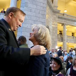 Sen. Jim Dabakis, D-Salt Lake City, makes amends with Utah Eagle Forum President Gayle Ruzicka at the signing of SB296 at the Capitol in Salt Lake City on Thursday, March 12, 2015.