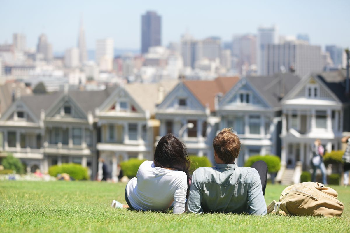 A young couple looking at Victorians in Alamo Square.