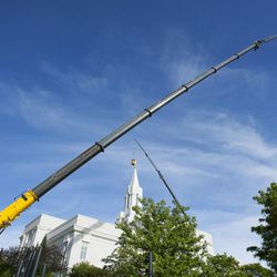 The Angel Moroni statue gets replaced on the Bountiful Utah Temple in Bountiful on Wednesday, June 1, 2016. Lightning struck the statue on May 22.