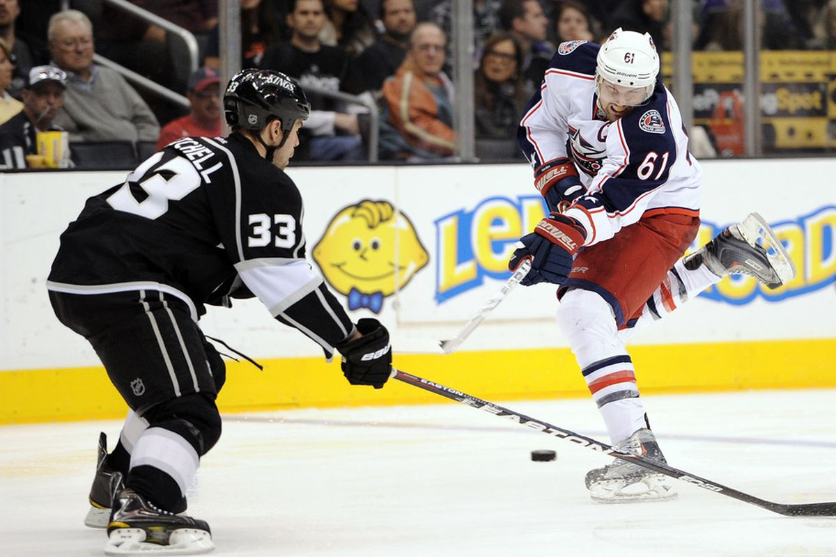 LOS ANGELES, CA - JANUARY 07:  Rick Nash #61 of the Columbus Blue Jackets takes a shot in front of Willie Mitchell #33 of the Los Angeles Kings at Staples Center on January 7, 2012 in Los Angeles, California.  (Photo by Harry How/Getty Images)