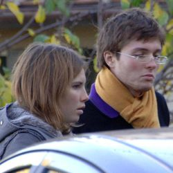 FILE - This Nov. 2, 2007 file photo shows Amanda Marie Knox, of the U.S., left, and her then-boyfriend Raffaele Sollecito, of Italy, outside the rented house where 21-year-old British student Meredith Kercher was found dead in Perugia, Italy. Sollecito, whose budding love affair with American exchange student Amanda Knox helped land him in an Italian prison for four years, maintains the couple's innocence in a new book but acknowledges that their sometimes bizarre behavior after her roommate's killing gave police reason for suspicion.