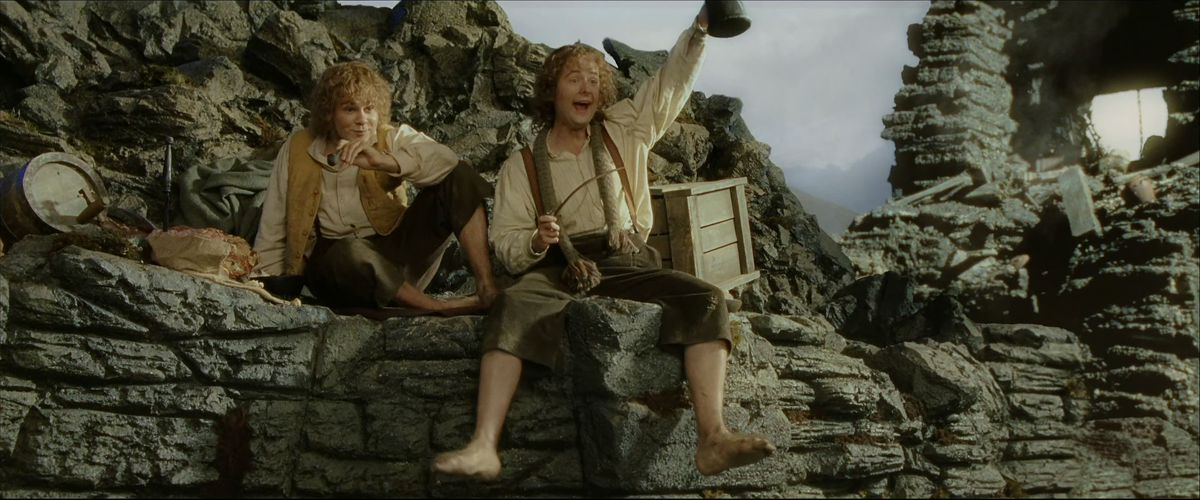 Merry and Pippin enthusiastically greet each other in the Isengard wreck in The Return of the King.