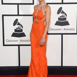 Guiliana Rancic in an orange (although look red on TV) number by Aussie designer Alex Perry.