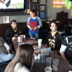 Hanging out with friends at Wits Inn, watching the Falcons game.