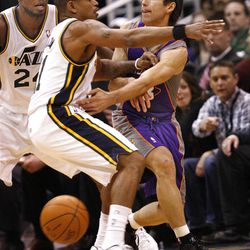 Sun's Steve Nash passes the ball as Utah's Earl Watson guards hin as the Utah Jazz are defeated by the Phoenix Suns 107-105 as they play NBA basketball Wednesday, April 4, 2012, in Salt Lake City, Utah.