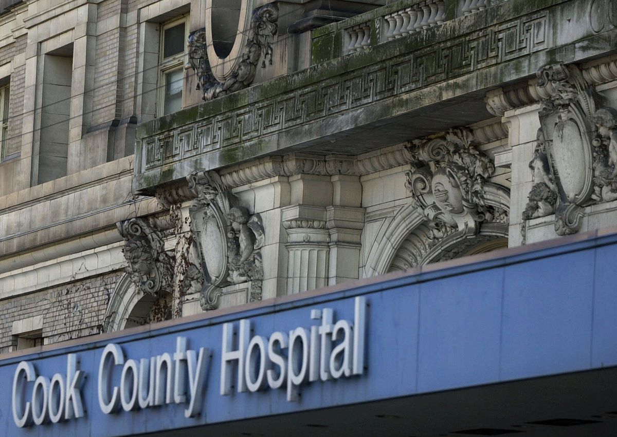 Decorative work on the exterior of the former Cook County Hospital building helped land the structure on the National Register of Historic Places. | Associated Press file photo