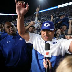 Brigham Young Cougars head coach Kalani Sitake celebrates the win as BYU defeats Utah in an NCAA football game at LaVell Edwards Stadium in Provo on Saturday, Sept. 11, 2021. BYU won 26-17, ending a nine-game losing streak to the Utes.