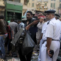 Egyptian street vendors salvage what they can of their belongings after police cleared Tahrir Square in Cairo, Egypt, Saturday, Sept. 15, 2012 after days of protests near the U.S. embassy over a film insulting Prophet Muhammad.