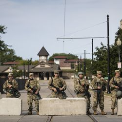 Members of the Wisconsin National Guard keep watch outside the Kenosha County Courthouse, more than a week after police shot Jacob Blake prompting unrest in the Wisconsin city, Tuesday morning, Sept. 1, 2020. President Donald Trump is scheduled to visit Kenosha Tuesday afternoon to survey areas affected by the unrest and meet with local officials.