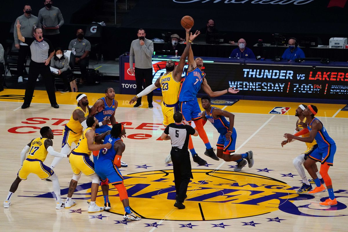 A general view of a jump ball between Los Angeles Lakers forward LeBron James (23) and Oklahoma City Thunder forward Darius Bazley (7) in the fourth quarter at Staples Center.