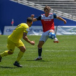 Tanner Tessmann (10) kicking the ball during the opening match of the 40th Annual Dallas Cup.