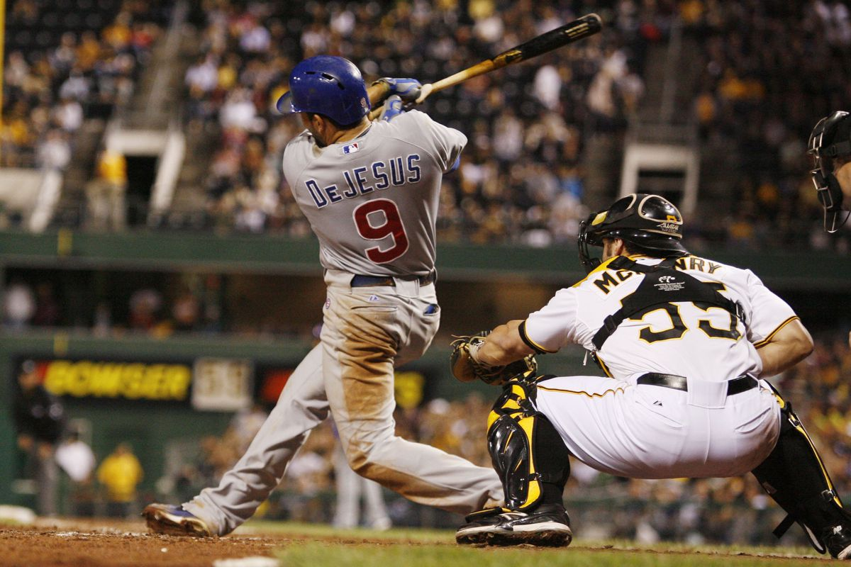 Pittsburgh, PA, USA; Chicago Cubs right fielder David DeJesus singles in the game-winning run against the Pittsburgh Pirates at PNC Park. The Chicago Cubs won 4-3. Credit: Charles LeClaire-US PRESSWIRE