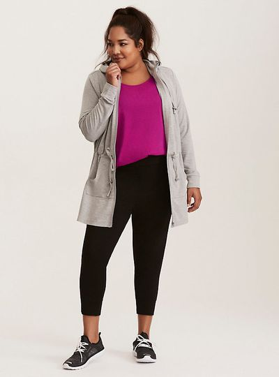 A model in Torrid workout clothes